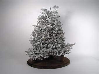 A very large metal fire ant colony cast.